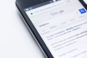 """A smartphone showing the Google SERP with the query, """"analytics."""""""