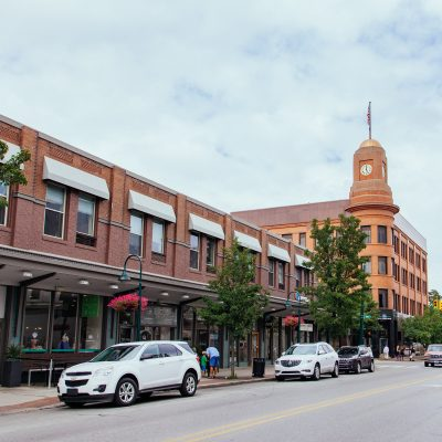 an image of front street in downtown traverse city with the fifth third bank bulding visible and cars on the street