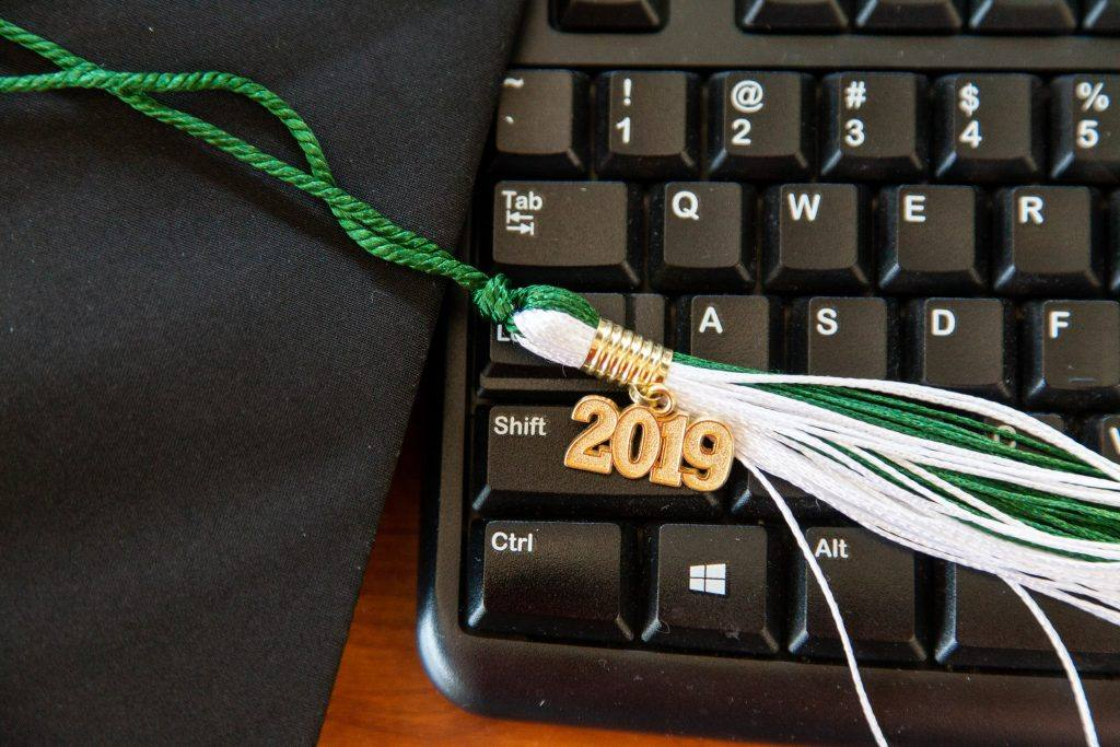 Keyboard with graduation hat tassle on it