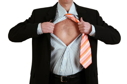 Image showing a man in a suit ripping his shirt off