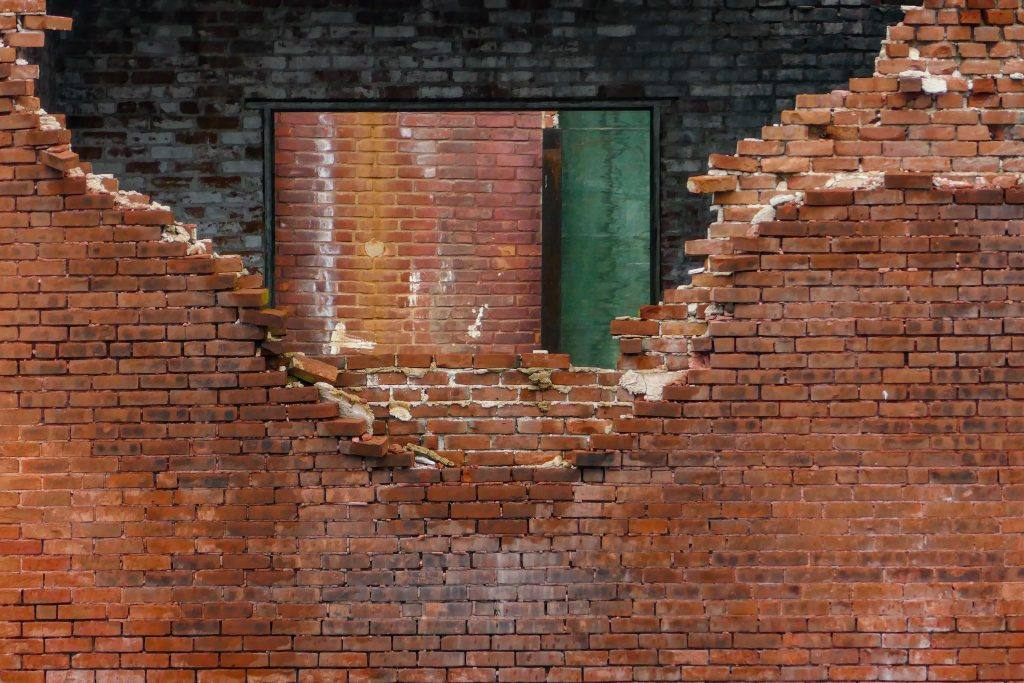 brick wall partially broken