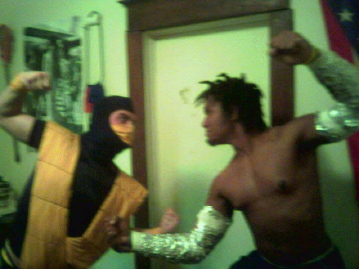 two men in costumes pretend to fight