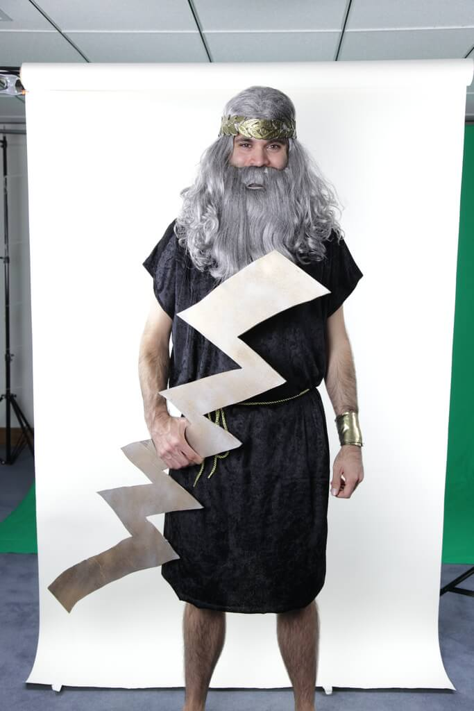 a man wearing a zues costume in an office