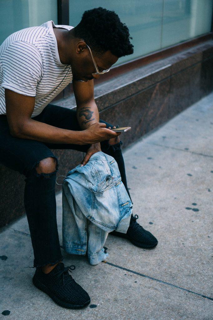 millennial checking his phone