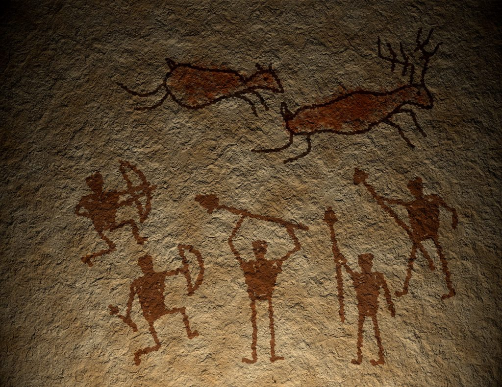 Brown colored cave drawings of people holding spears chasing animals.