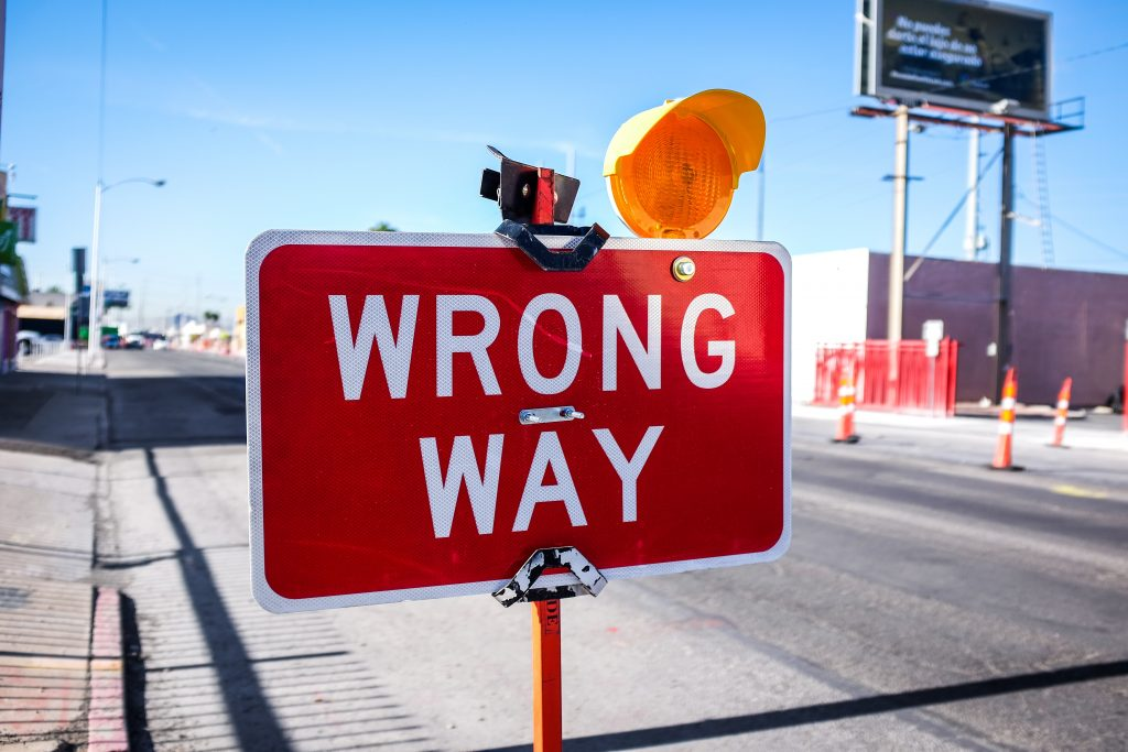 Street sign that says wrong way.