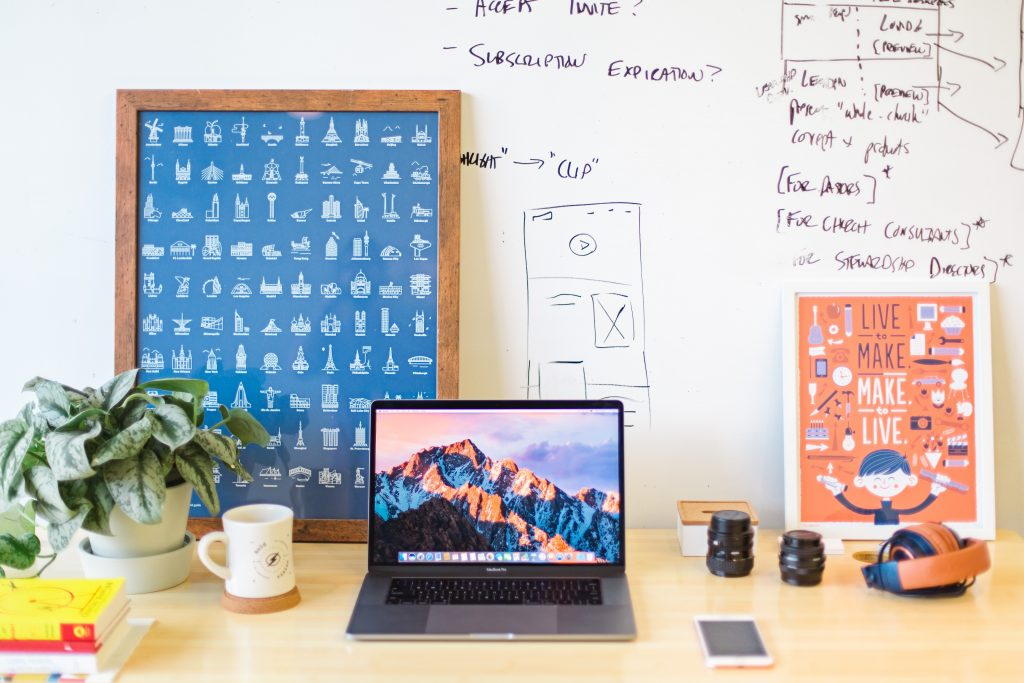 A hip, colorful, and well organized desk.