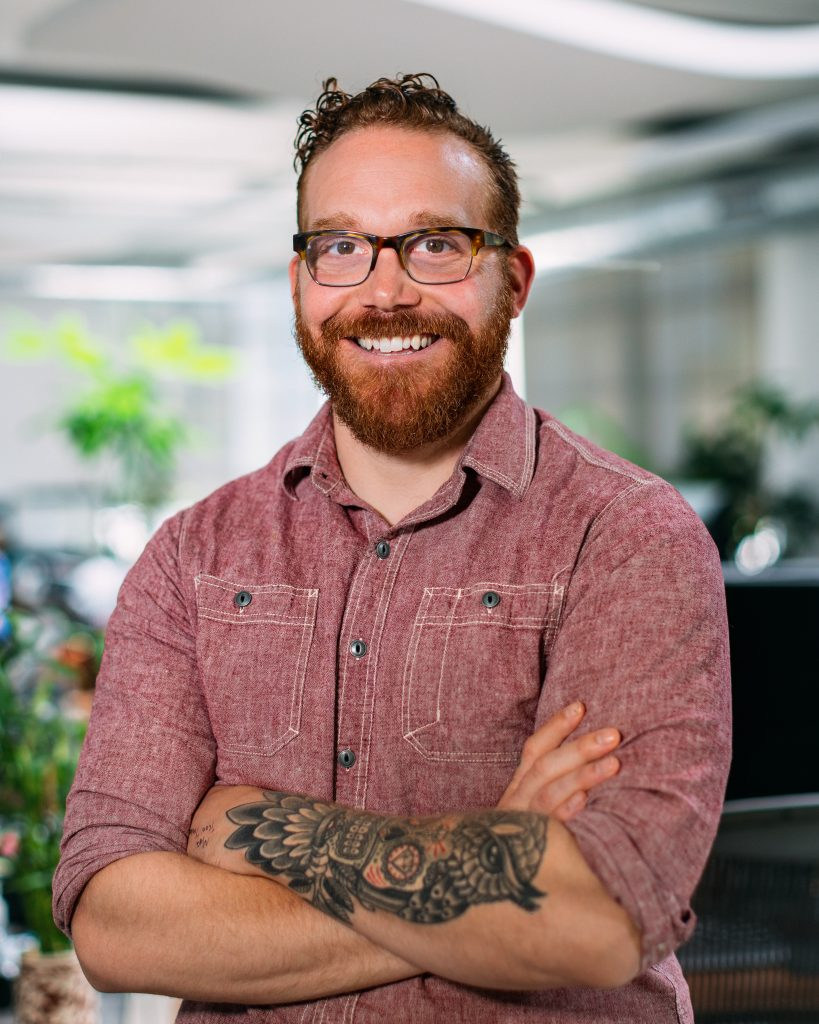A professional headshot of a male Oneupweb marketing employee Nate Totten.