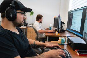 oneupweb developer works at his desk