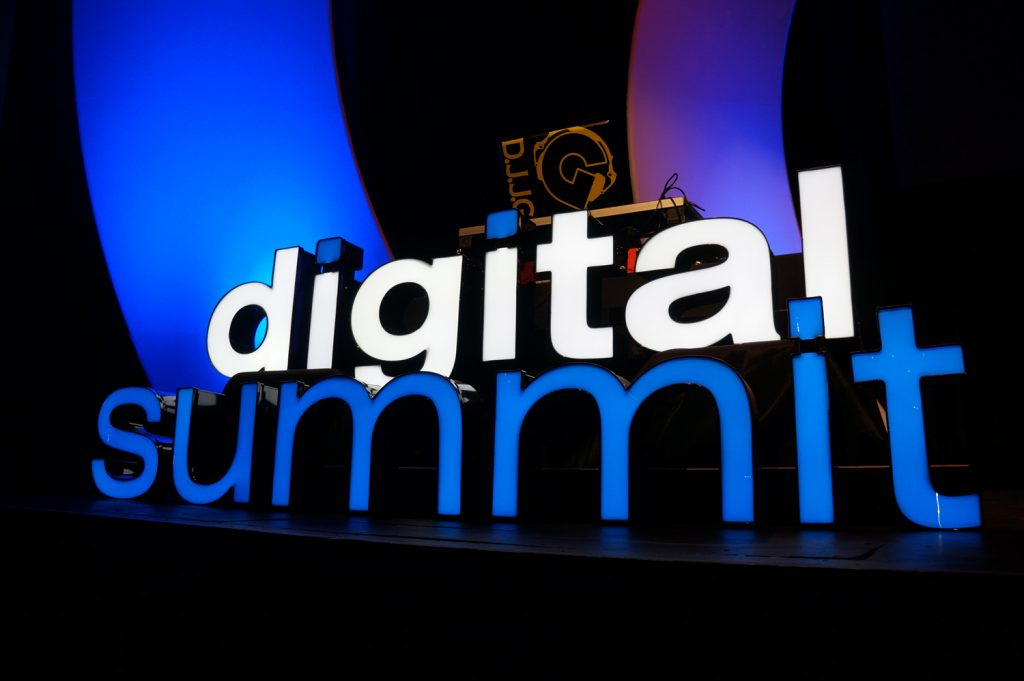 Digital Summit sign on a stage.