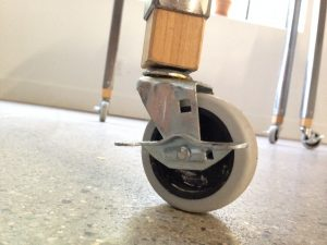 The wheel of a swivel table.