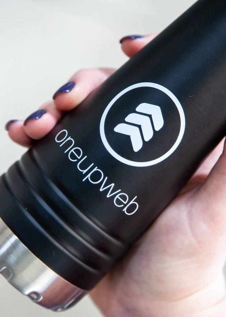 black water bottle with oneupweb logo