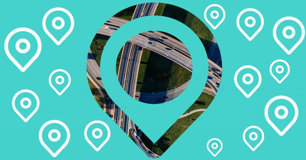 graphic of many location marker icons with large cutout in the shape of a location marker with highway aerial shot