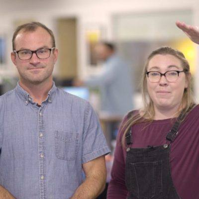 a man, left, and woman explain what is content marketing