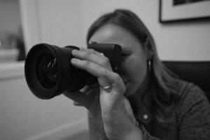 Video marketing expert adjusts her camera lens