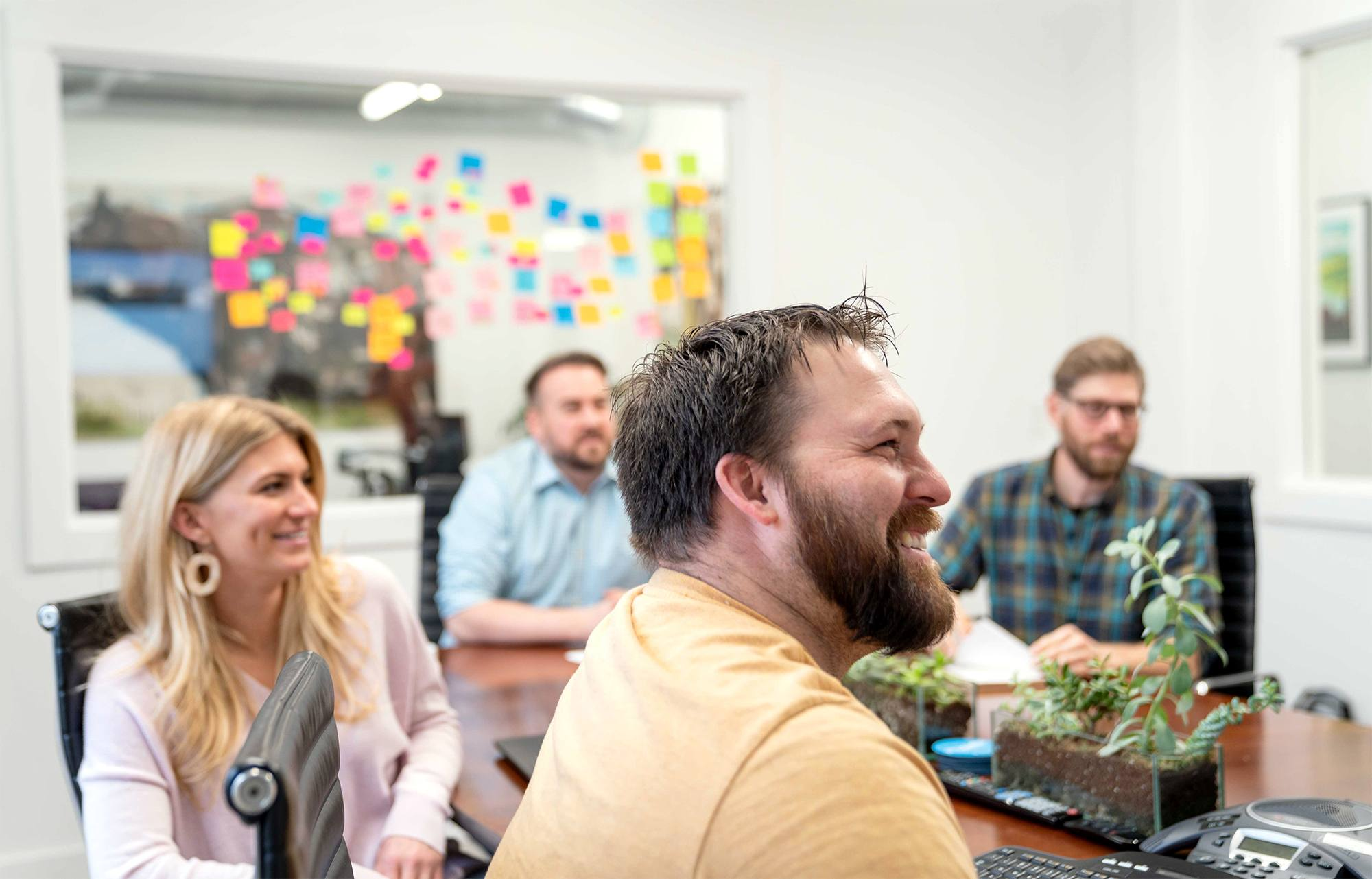 oneupweb digital marketing team smiling, planning, and strategizing