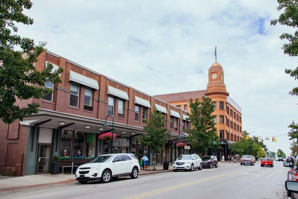 Downtown Traverse City, featuring a gold-capped clock tower with a flag