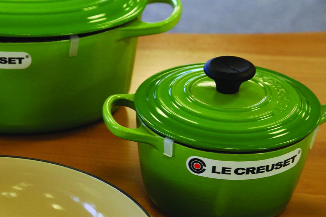 Le Creuset enamel cookware on a countertop