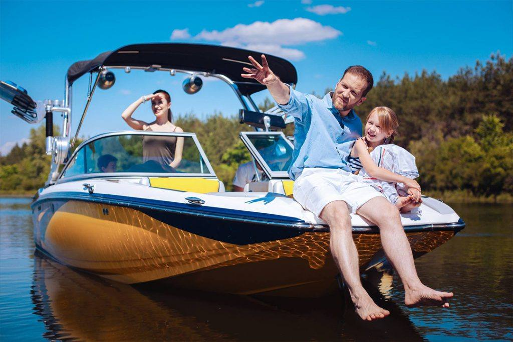 a young man, his wife, and his daughter boating on a lake
