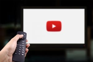 Man changing using a TV remote while watching Youtube. on Smart