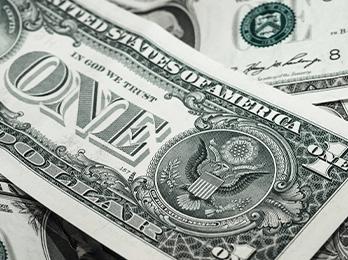 Dollar bills scattered