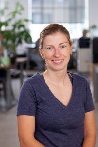 Headshot of Oneupweb female employee smiling in office