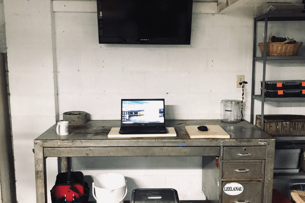 Employees remote office which is a desk in a garage