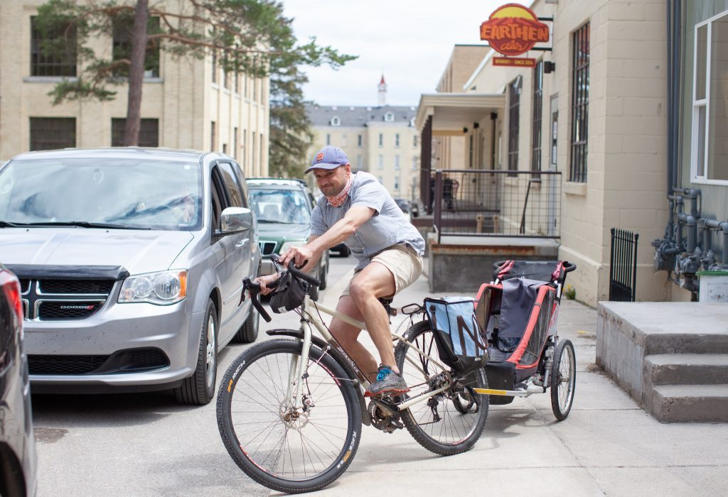 Man riding bike to pick up food while working remotely