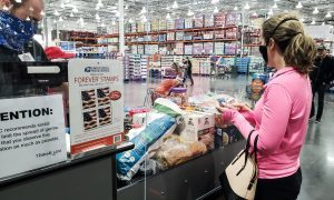 Millennial wearing face mask grocery shopping during pandemic