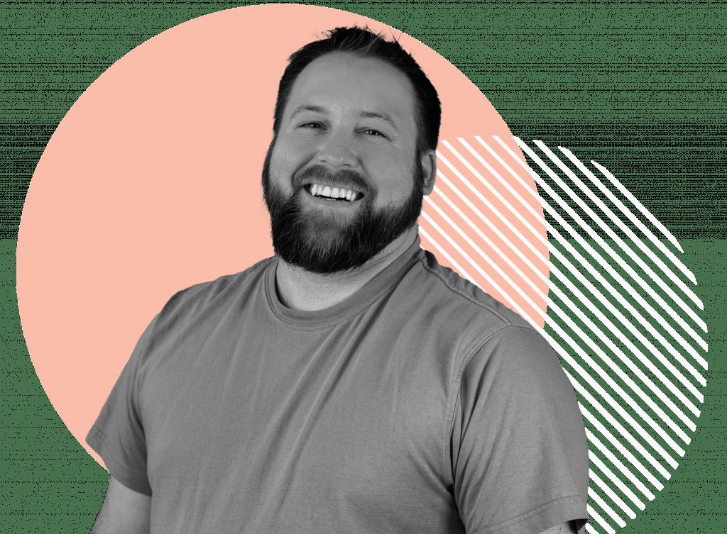 Oneupweb employee David Kehrer smiling in front of a circle background