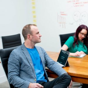 team of marketers in a meeting room offering consulting to a client