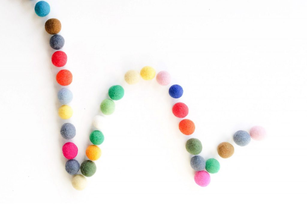 Bouncing colorful fuzzy felt balls represent fluctuations in SEO performance