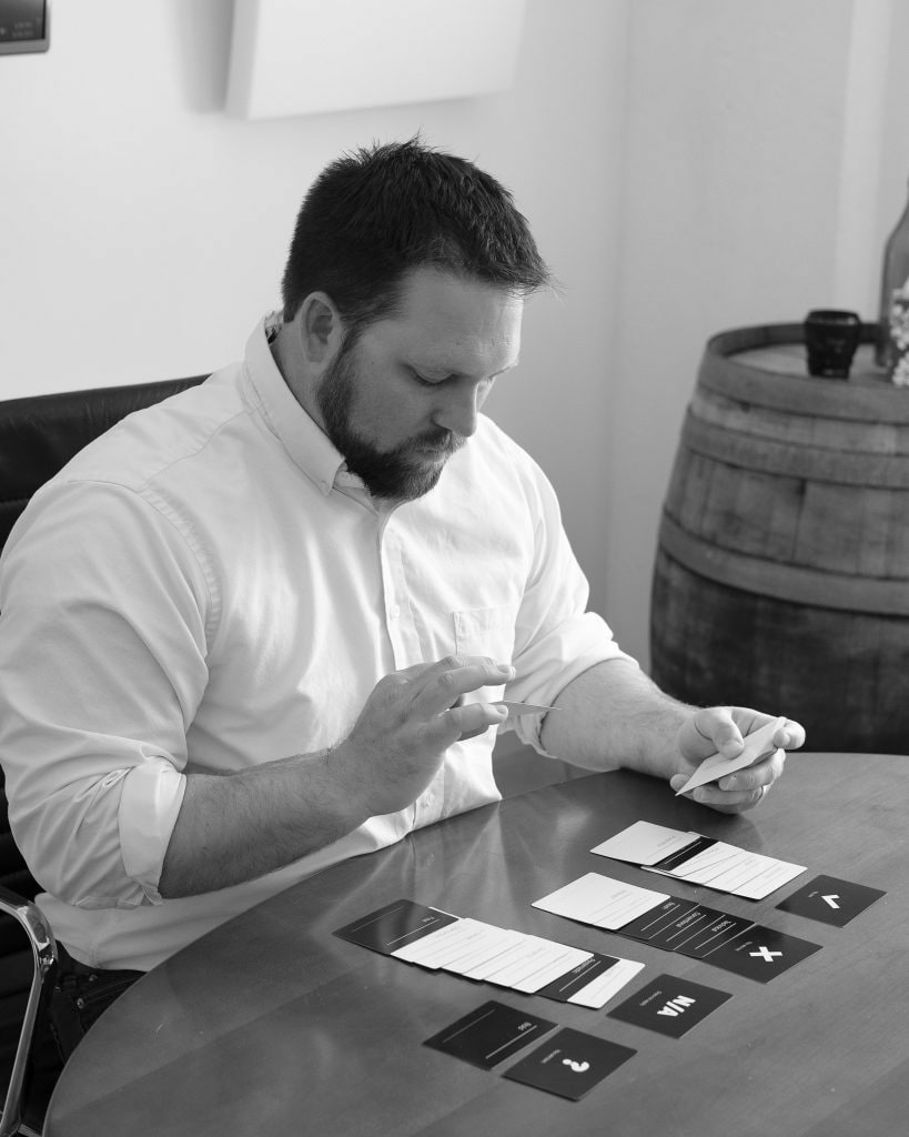 Male Oneupweb employee doing a branding exercise with cards.