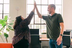 a website designer and a website developer high five